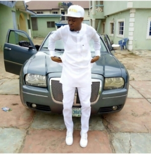 Yoruba Comic Actor, Monsuru, Poses With His Car
